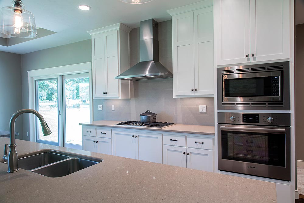 New Construction Transitional Story Kitchen